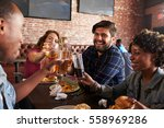 friends eating out in sports... | Shutterstock . vector #558969286
