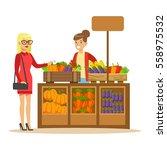 woman buying fresh vegetables... | Shutterstock .eps vector #558975532