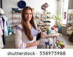 teenage boutique assistant... | Shutterstock . vector #558975988
