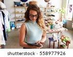 female business owner using... | Shutterstock . vector #558977926
