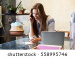 young woman working in clothing ... | Shutterstock . vector #558995746