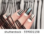 gray striped nail design on... | Shutterstock . vector #559001158
