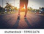 handsome man running on road... | Shutterstock . vector #559011676