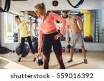 healthy athletes exercise with... | Shutterstock . vector #559016392