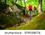 a couple riding their mountain... | Shutterstock . vector #559038076