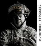 firefighter portrait sepia | Shutterstock . vector #559066852