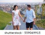 Stock photo couple holding hands on a walk 559069915