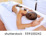 young woman is enjoying hot... | Shutterstock . vector #559100242
