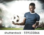 player holding soccer ball in... | Shutterstock . vector #559103866