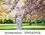 beautiful young woman enjoying... | Shutterstock . vector #559162918
