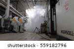 Small photo of Firefighters practice sealing of leak accident from corrosive toxic hazardous material Ammonia liquid container in fruit factory dressing protective suites, Yesud Hamaala, Israel, March 21, 2016.