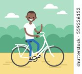 young black man riding a bike... | Shutterstock .eps vector #559226152