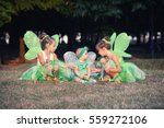 baby and two girls in a green... | Shutterstock . vector #559272106