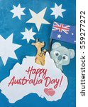 Small photo of Celebrate Australia-Day holiday on January 26 with a Happy Australia Day message greeting written card across Australian maps and flag hanging pegs on blue background. Toned collage