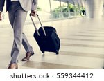 businessman hold luggage... | Shutterstock . vector #559344412