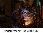 welder is welding metal part in ... | Shutterstock . vector #559380232