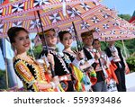 Small photo of Sabah ,Malaysia -January 18,2017 : Beautiful Dusun Tindal ethnics with colourful traditional costume.