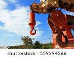 crane hook on a blue sky | Shutterstock . vector #559394266