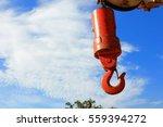 crane hook on a blue sky | Shutterstock . vector #559394272