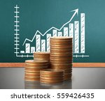 investment concept  coins graph ... | Shutterstock . vector #559426435