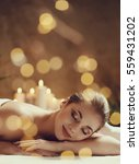 massage. beautiful girl in spa... | Shutterstock . vector #559431202