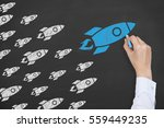 rocket leadership concept on... | Shutterstock . vector #559449235