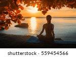 Stock photo serenity and yoga practicing at sunset meditation 559454566