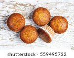 banana cupcakes on white rustic ... | Shutterstock . vector #559495732