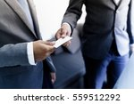 business executive exchanging... | Shutterstock . vector #559512292