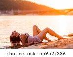 girl on the beach in the... | Shutterstock . vector #559525336