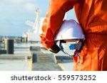 orange robe engineer with... | Shutterstock . vector #559573252