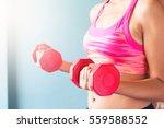 woman in pink sport bra holding ... | Shutterstock . vector #559588552