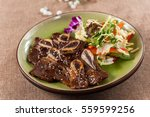 beef short ribs with salad | Shutterstock . vector #559599256