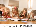 large group of children write... | Shutterstock . vector #559604092