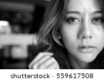 Stock photo close up face beautiful young woman lonely looking fear about the past depressed in black and 559617508