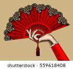 female hand with red open fan.... | Shutterstock .eps vector #559618408