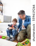 father and son assembling... | Shutterstock . vector #559619266