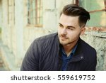 handsome man on grunge building ... | Shutterstock . vector #559619752