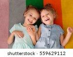 adorable little sisters lying... | Shutterstock . vector #559629112