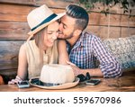 Stock photo young fashion couple of lovers at beginning of love story handsome man whispers sexy kisses in 559670986