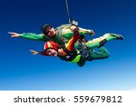 tandem jump. the girl with the... | Shutterstock . vector #559679812