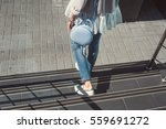 blue round bag in the hands of... | Shutterstock . vector #559691272
