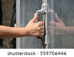 woman's hand close up opening... | Shutterstock . vector #559706446
