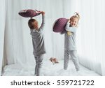 children in soft warm pajamas... | Shutterstock . vector #559721722