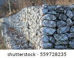 retaining stone wall next to... | Shutterstock . vector #559728235