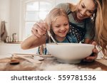 young family cooking food in... | Shutterstock . vector #559781536