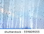 water drops on window glass | Shutterstock . vector #559809055