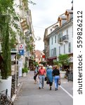 Small photo of Aix-les-Bains, France - Sep 4, 2015: Rue Albert 1st incentral Aix-Les-Bains with pedestrians walking on a calm summer day on the shoping street