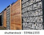 gabion fence wall | Shutterstock . vector #559861555