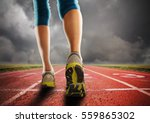 an athletic pair of legs going... | Shutterstock . vector #559865302